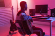 canvas print picture - Create music and a recording studio concept - african american man guitarist recording electric guitar track in home studio
