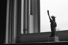 Replica Of Statue Of Liberty On Window Sill At Home