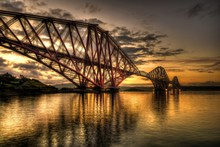 Firth Of Forth Rail Bridge Over River Against Sky During Sunset