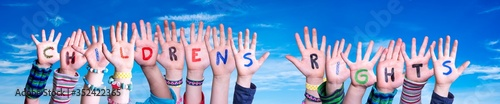 Obraz Children Hands Building Colorful English Word Children Rights. Blue Sky As Background - fototapety do salonu
