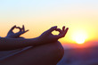 canvas print picture - Woman hands at sunset relieving stress doing yoga