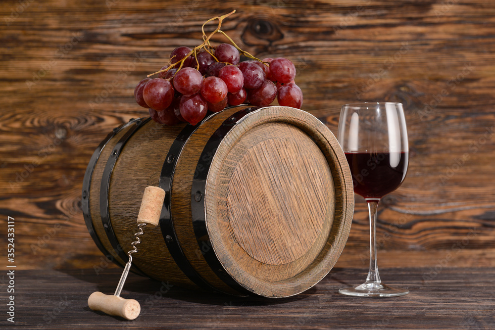 Fototapeta Wooden barrel of wine and glass on table