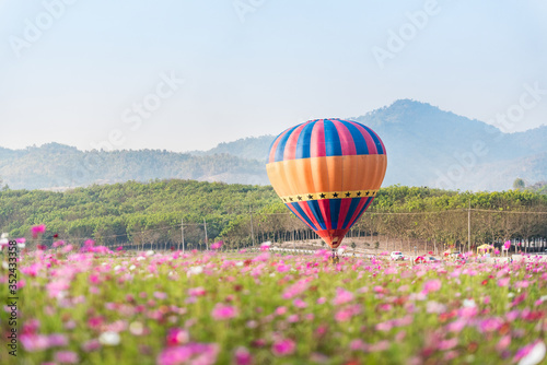 Hot Air Balloons On Landscape Against Clear Sky Fototapet