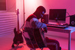 canvas print picture - Musician and making music concept - African american male sound producer working in recording studio.