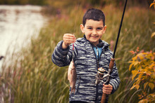 Cute Boy Catches Fish On A Sum...