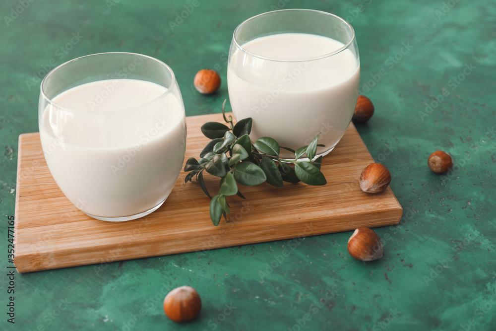 Fototapeta Glasses of tasty hazelnut milk on table
