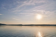 Beautiful sundown on lake with rocky shore.
