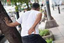 Old Man Suffering From Back Pain, Herniated Disc Or Kidney Failure
