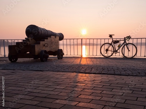 Tela Bicycle By Cannon On Promenade Against Sky During Sunset