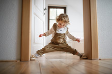 Small Toddler Girl Standing Indoors At Home, Having Fun.