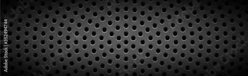 Obraz na płótnie Black perforated background with black holes and glow