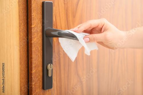 Obraz Woman disinfecting door handle, closeup - fototapety do salonu