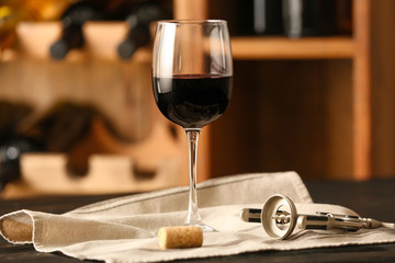 Glass of wine on table in cellar