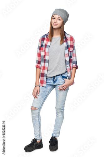 Smiling relaxed teen girl standing in full length