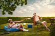 Leinwandbild Motiv Two funny nerds relaxing in the backyard on the summer day