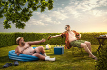 Two Funny Nerds Relaxing In The Backyard On The Summer Day