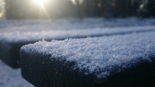 Close-up Of Snow On Wooden Bench
