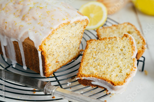 Glazed lemon pound cake loaf with poppy seed on cooling rack Wallpaper Mural
