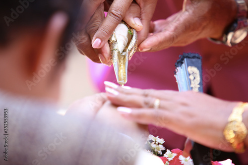 Canvas Cropped Image Of Bride And Groom Doing Rituals During Wedding