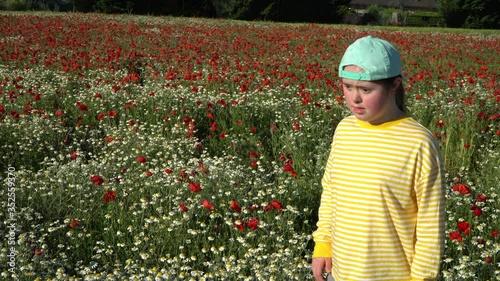 Fototapeta Girl on background of the flowers field