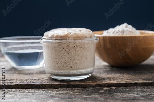 Obraz Heaping jar of sourdough starter yeas - fototapety do salonu