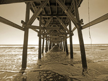 Low Angle View Of Pier Over Se...