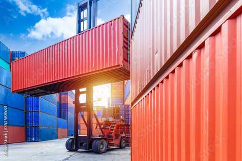 Container stacker crane lifting up stacking container box in yard, Container loading cargo freight in import and export business logistic company, Industry logistic and transportation