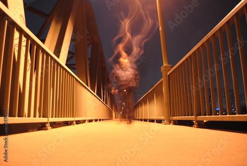 Wallpaper Mural Blurred Motion On Man On Footbridge