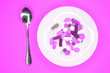 canvas print picture - white plate with pills and spoon on turquoise background