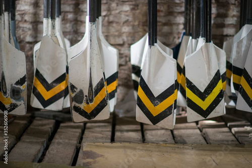 Photo Metallic Oars At Workshop