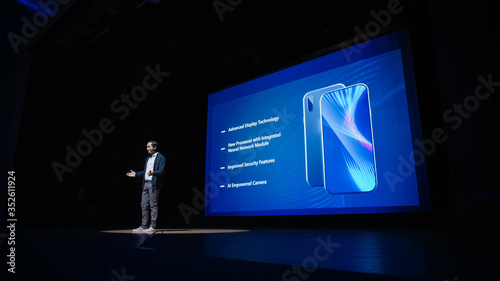 Vászonkép Live Event with Brand New Products Reveal: Speaker Presents Smartphone Device to Audience