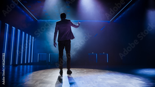 Famous Entertainer Stands on Stage, Greets Audience, Starts Performance Wallpaper Mural