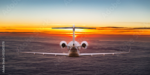 Obraz Small private jetplane flying above beautiful clouds. Travel and transportation concept. - fototapety do salonu