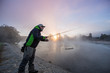Leinwanddruck Bild - Men fishing in river with fly rod during summer morning. Beautiful fog.