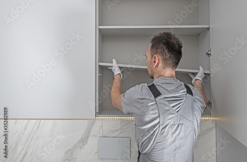 Obraz Men Installing Modern Bathroom White Cabinets - fototapety do salonu