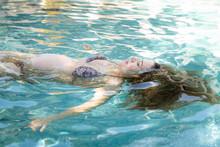 A Pregnant Woman Floats Peacef...