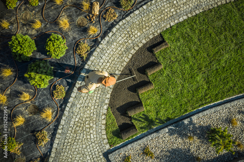 Obraz Gardener in Newly Build Backyard Garden - fototapety do salonu