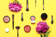 canvas print picture - Professional makeup brushes, powder, eyeshadow, blush, lipstick cream on yellow background flat lay top view copy space. Beauty product women's accessory fashion. Different brushes Cosmetic makeup Set