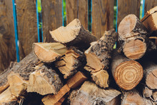 Stacks Of Firewood In The Sawmill. Pile Of Firewood. Firewood Background.