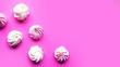 Leinwandbild Motiv Tasty fresh meringue on bright pink background, top view, copy space for the text