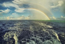Scenic View Of Double Rainbow Over Sea Against Sky