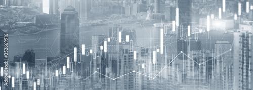Fototapeta Stock trading, investment, candle stock market chart diagram website header banner city view skyline.