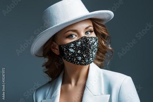 Elegant woman wearing trendy fashion outfit during quarantine of coronavirus outbreak Canvas-taulu