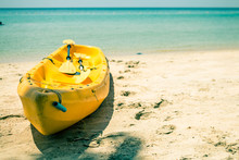 Close-up Of Yellow Boat On Beach