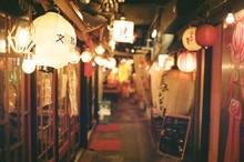 Illuminated Chinese Lanterns Hanging Outside Stores