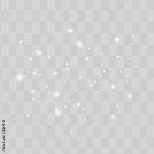 The dust sparks shine with special light. Vector sparkles on a transparent background. Christmas light effect. Sparkling magical dust particles. Wall mural