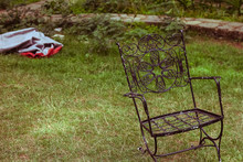 Wrought Iron Chair In The Grou...