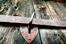 Rusty Metallic Handle On Old Wooden Door