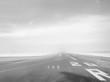 Empty Airport Runway Against Sky