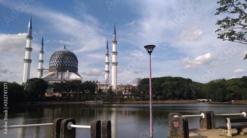 Sultan Salahuddin Abdul Aziz Mosque By Lake Against Sky Wallpaper Mural